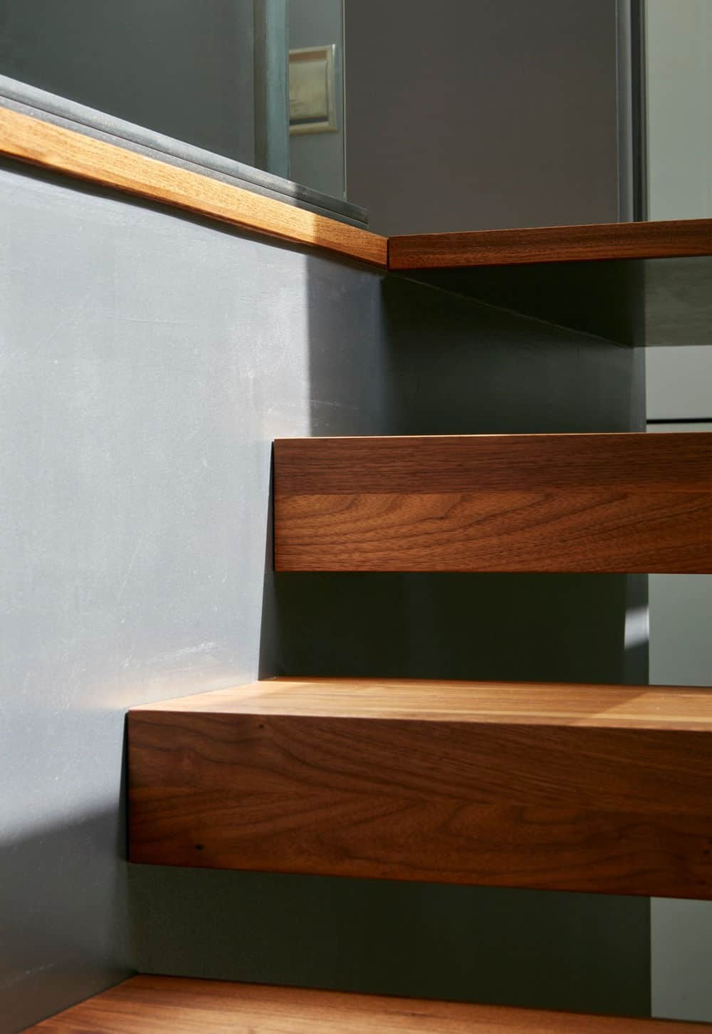 Close up look of the staircase's hardwood steps. Photo Credit: James Brittain