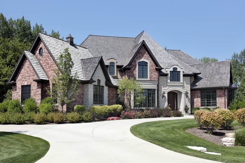 Stylish suburban house with u-shaped light concrete driveway