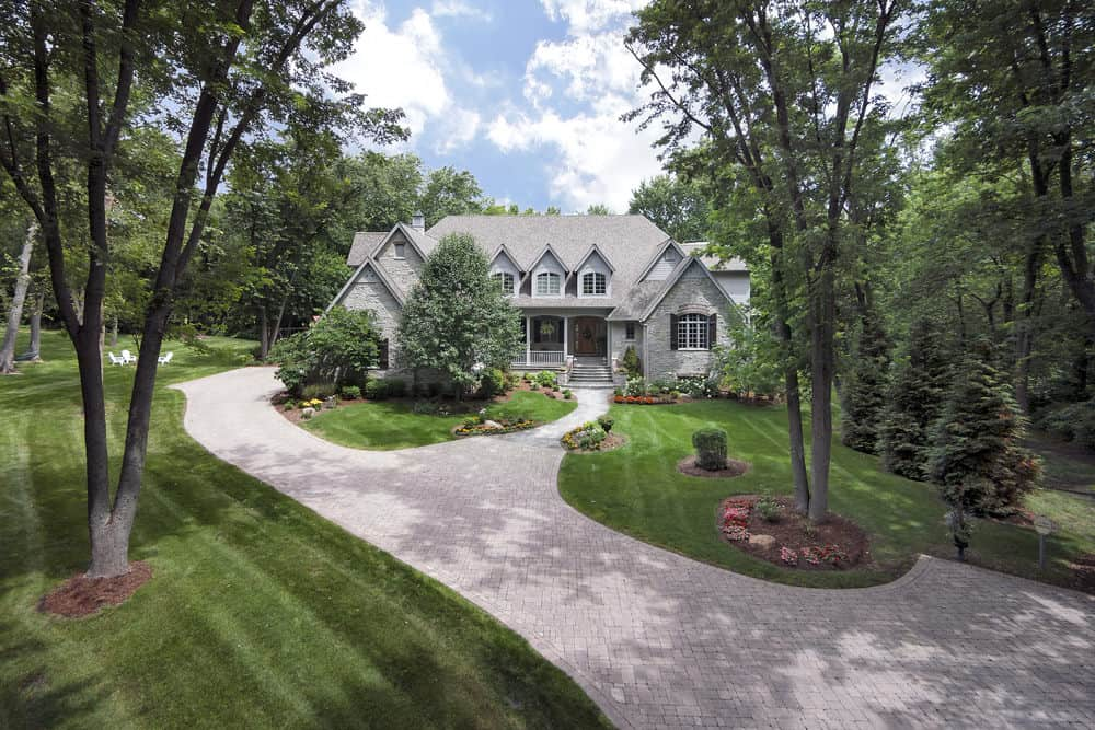 Here's another example of what appears to be circular driveway is, in fact, a walkway extending from the main driveway. I included it because it's clever and looks great and gives the impression of a circular driveway.