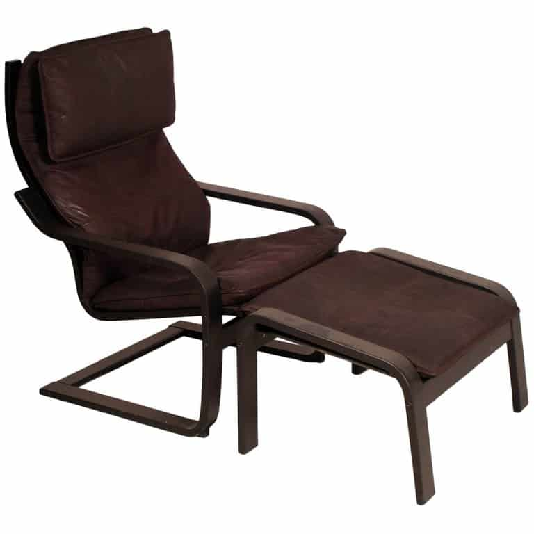 Brown Poäng chair with a matching footstool.