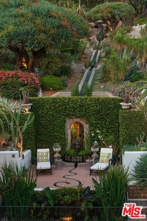 An aerial view of the house's backyard boasting its healthy and beautiful plants and trees.