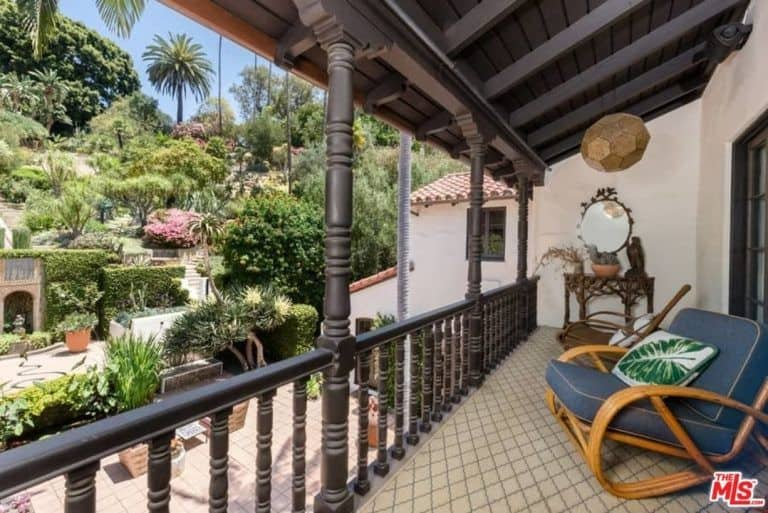 The private balcony overlooks the beautiful outdoor of the property while also offering a relaxing seat.