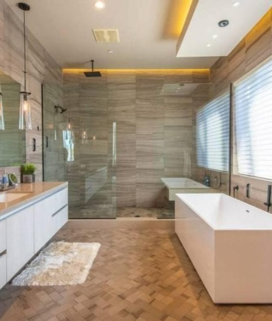 The bathroom looks elegant and complete with a deep soaking tub, walk-in shower and a beautiful sink.