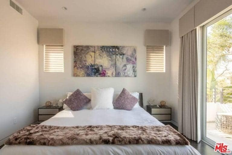 Another bedroom has a queen size bed and has access to a private balcony.