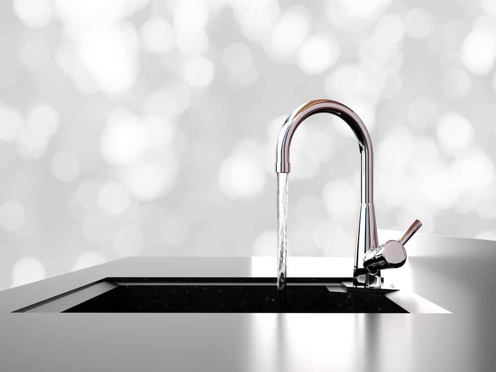 Kitchen faucet against blokeh backdrop.