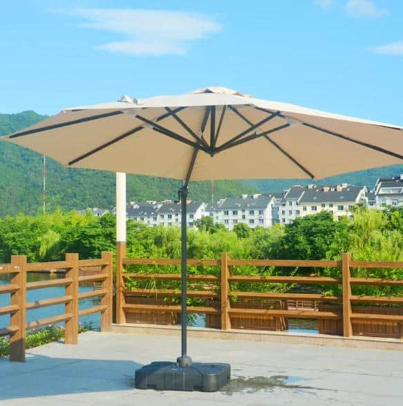 A large, tilted patio umbrella in a fresh beige tone.