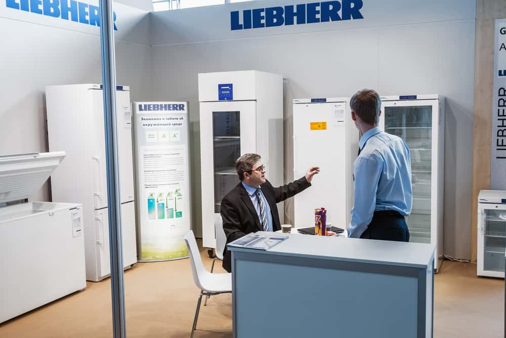 Two men having a conversation during the 14th International Exhibition of laboratory equipment and chemical reagents in Moscow.