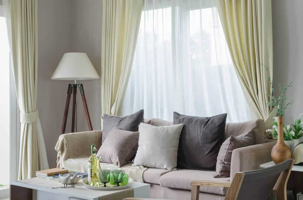 Living Room With Sheer, White And Yellow Curtains.