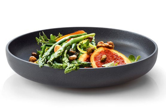 Blomus cast iron serving bowl is used for serving fruits or nuts and it is durably constructed with cast iron with metal accents.