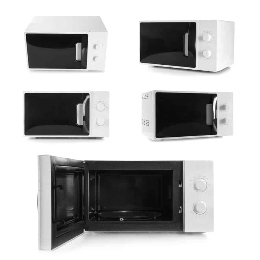 A set of white microwave ovens in a white background.