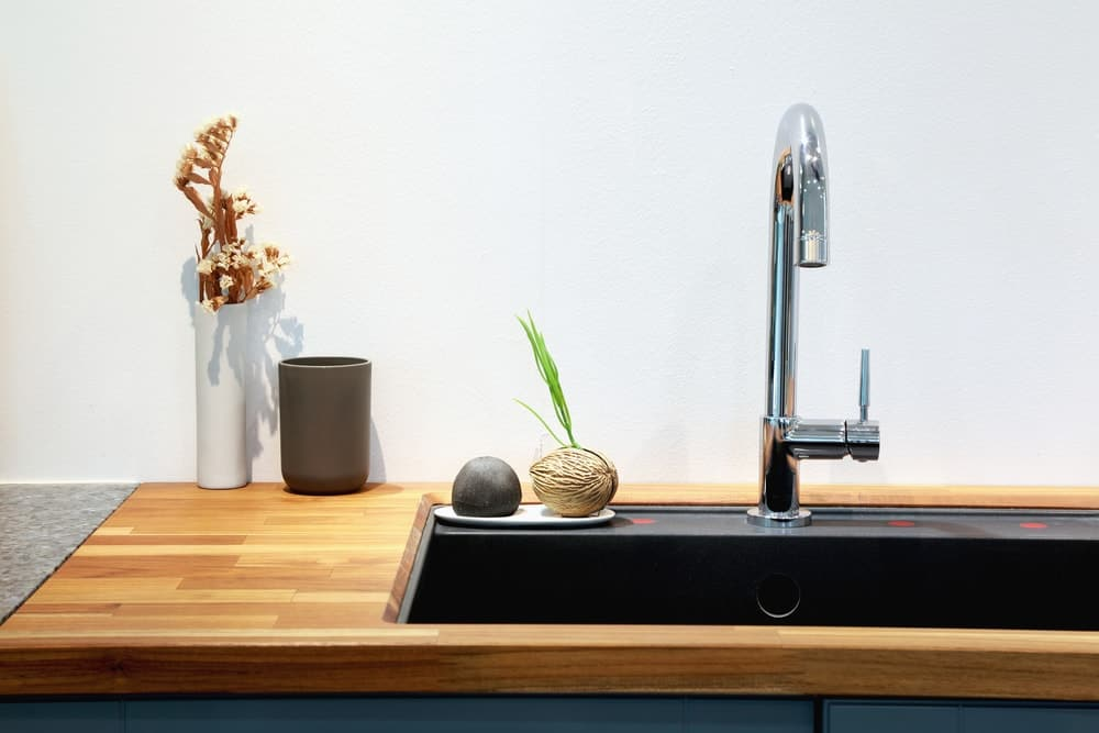 Modern sink with kitchen faucet.