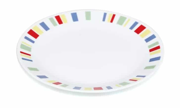 "Livingware Memphis 10.25"" dinner plate with a white base color and colorful pattern on its outer rim."