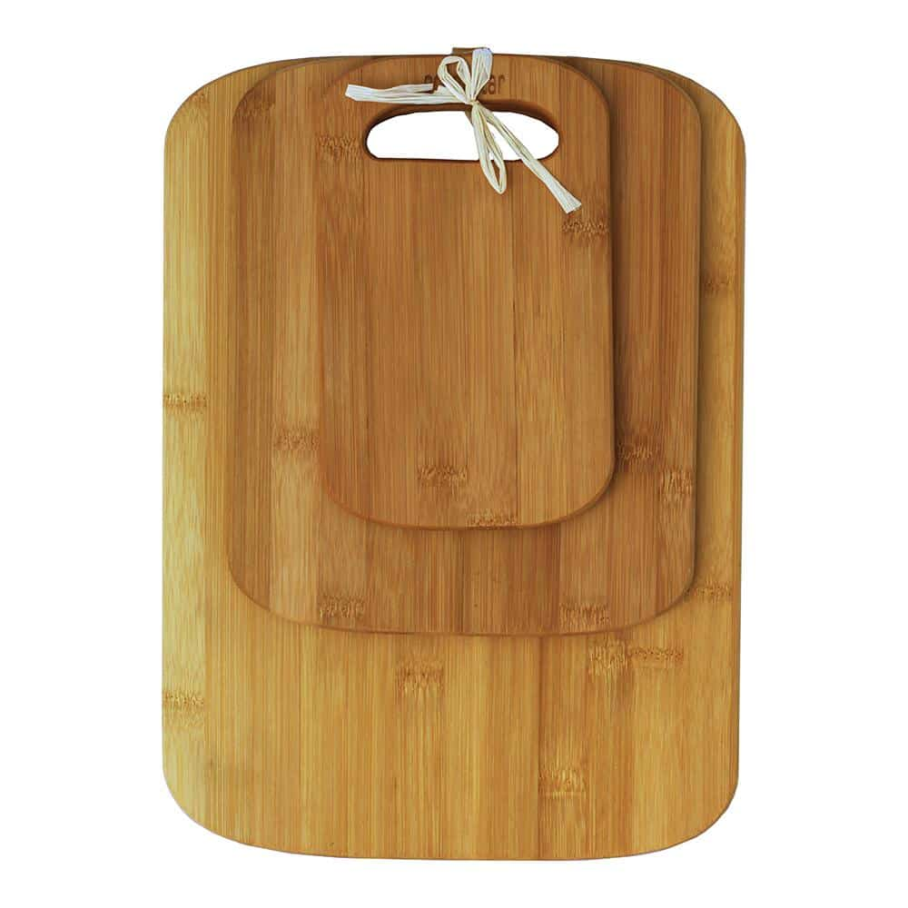 A set of bamboo cutting boards with rounded and smoothed edges.