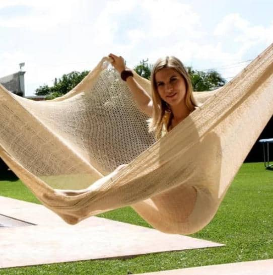 Mayan hammock made out of natural-toned cotton fabric.