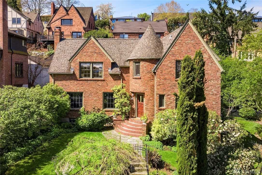 old house with red brick exterior on hill