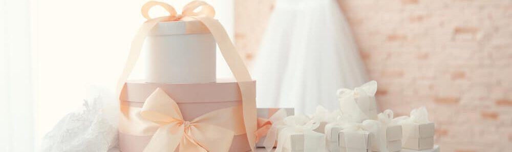 Pastel-colored gift boxes with ribbons.