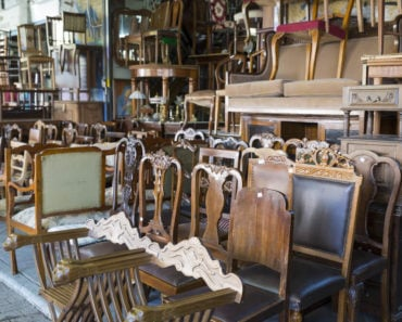 A display of second hand, wooden furniture.