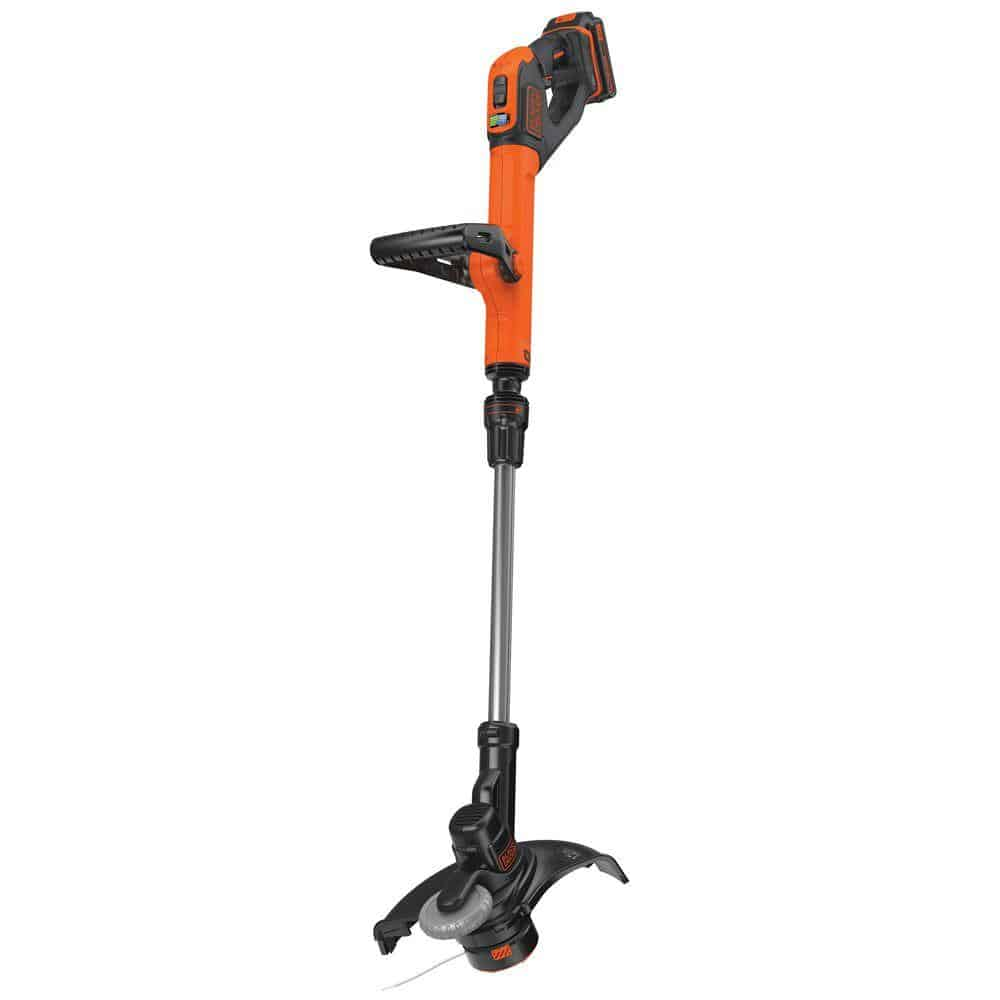 A string lawn edger in an orange and black finish.