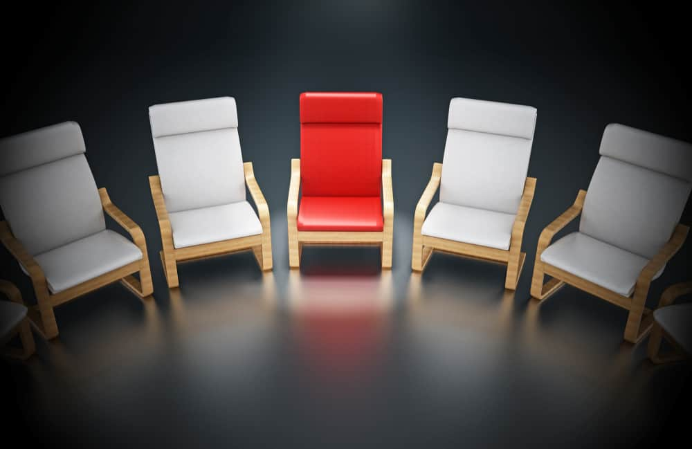 Modern POÄNG chairs in colors of white and red chair in the middle.