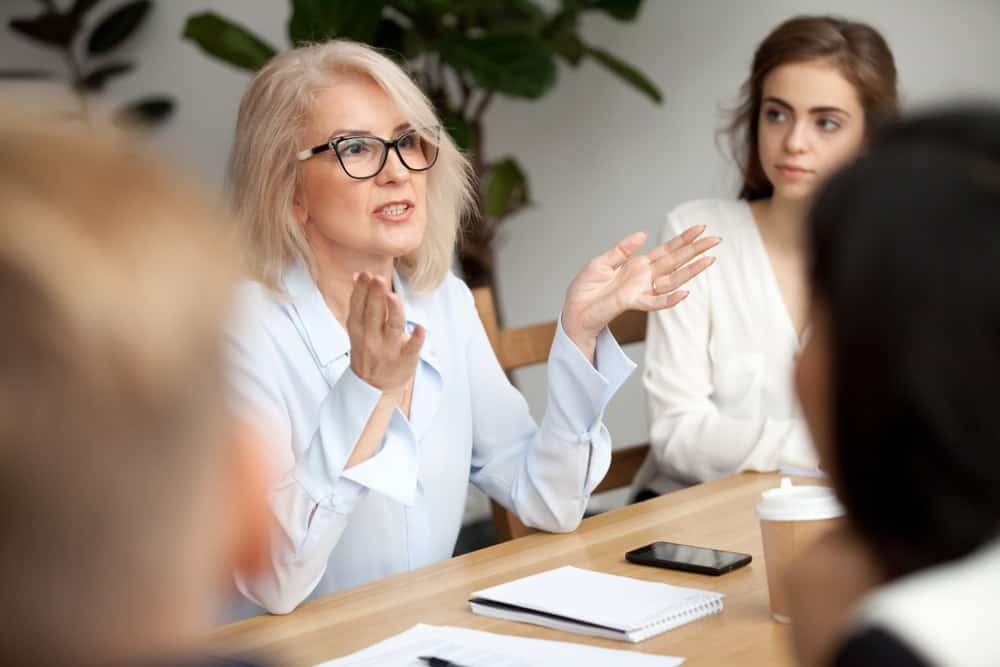 Woman talking with gestures during a company meeting.