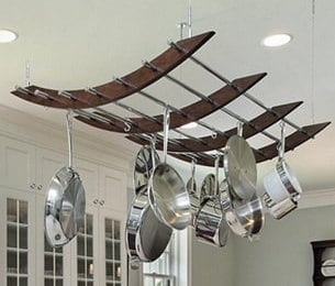 Handmade rustic and industrial pot rack made with reclaimed wood, stainless steel and aircraft cable.