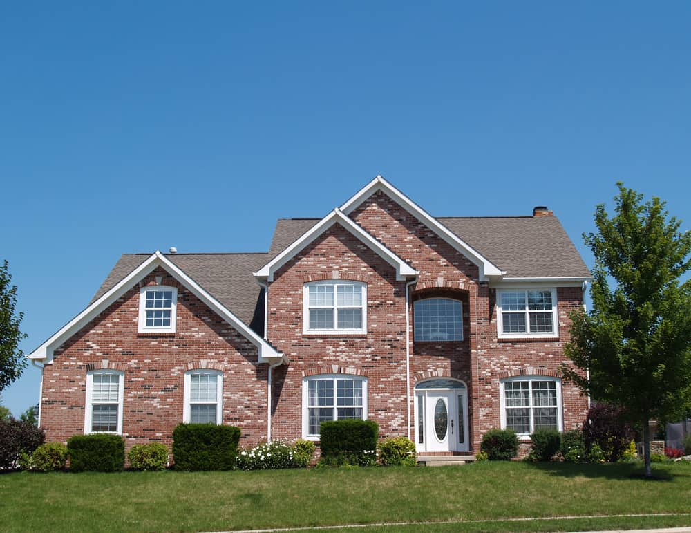 Verging on McMansion status this red brick has flecks of dark grey and white giving it a varied exterior look.