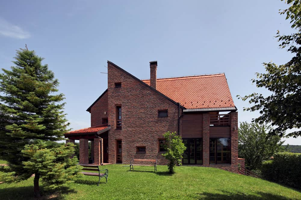 Interesting modern home design with extensive red brick exterior as well as red tile roof. It works as far as I'm concerned.