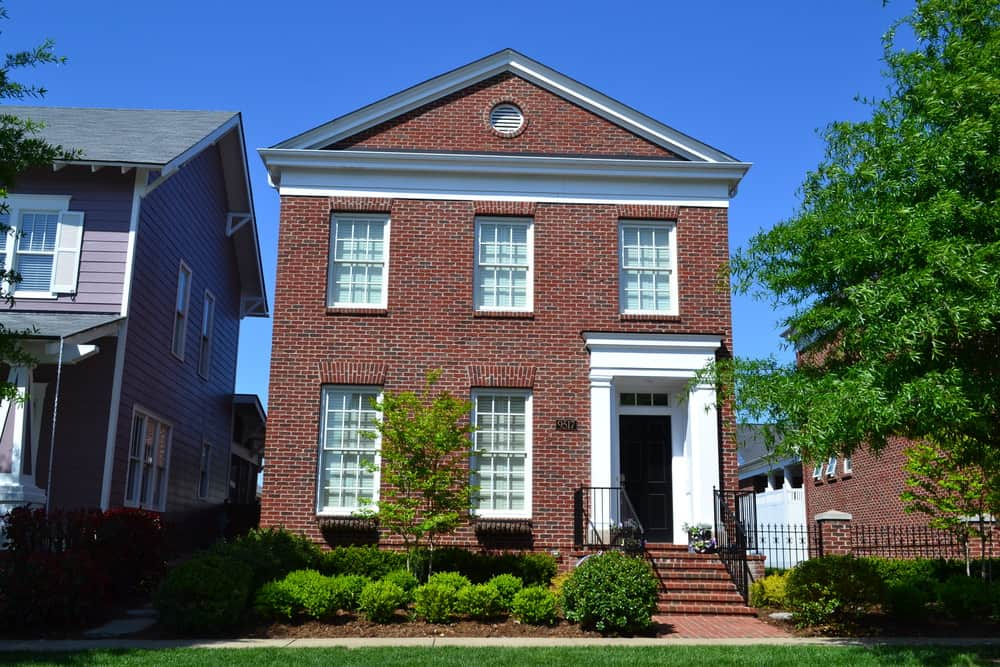 Urban red brick home akin to a townhouse yet it's detached. I like it.