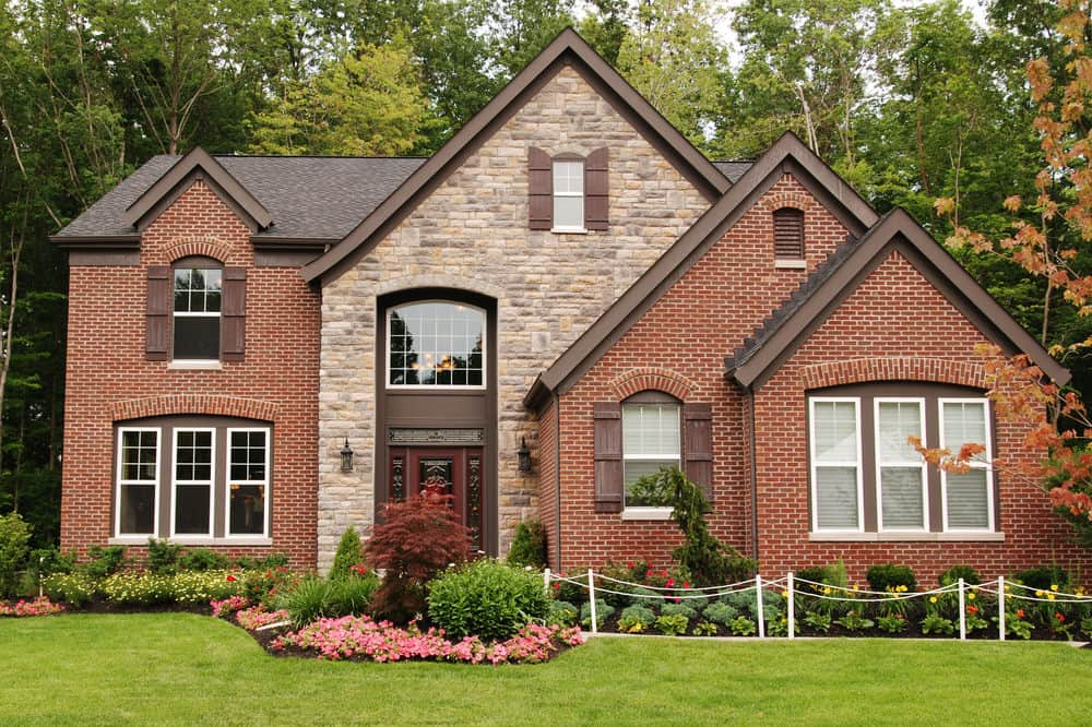 Suburban home with brick and stone combination facade.