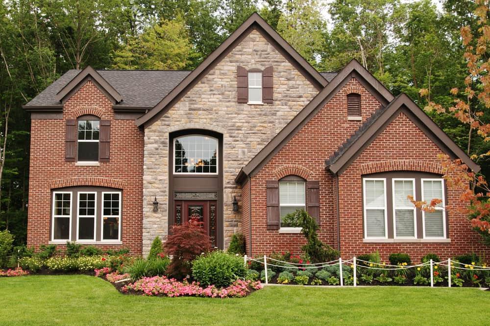 Suburban home with brick and stone combination facade.