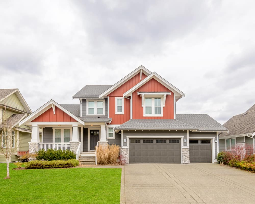 Red suburban home with gray and white. I love the red and gray combination. The neutral gray tempers the red and of course the white trim is always an excellent color for red houses.