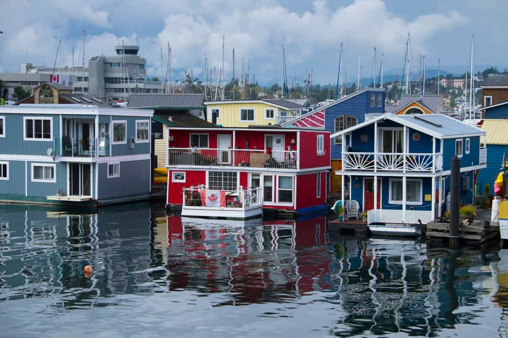 Photo of a red floating home with white trim.