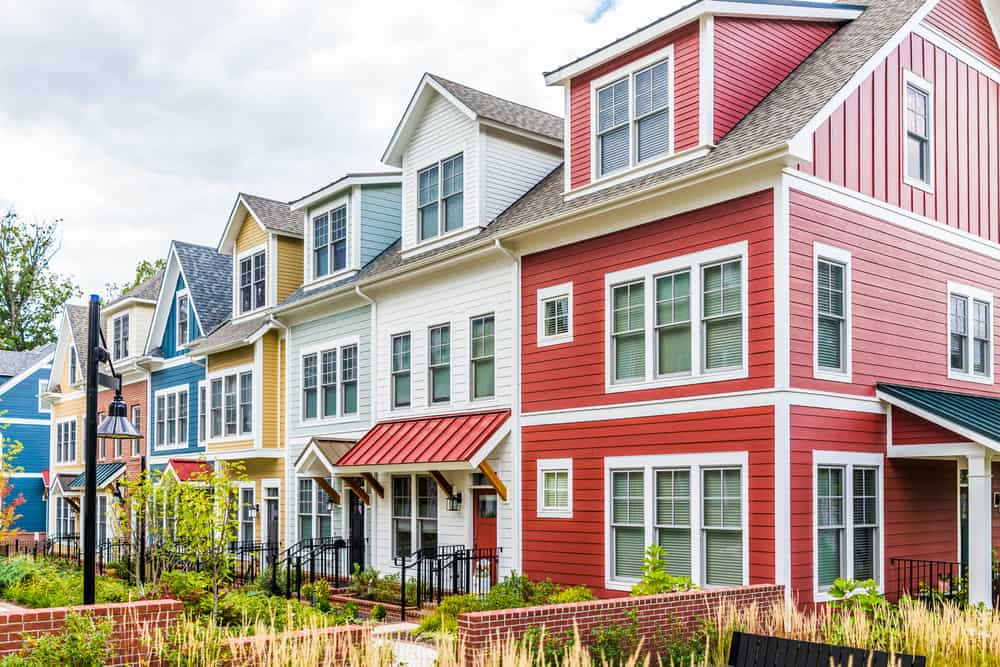 Row of colorful townhouses that include yellow, blue, green, white and red. I love the colorful row which goes well with the historic design of the homes.