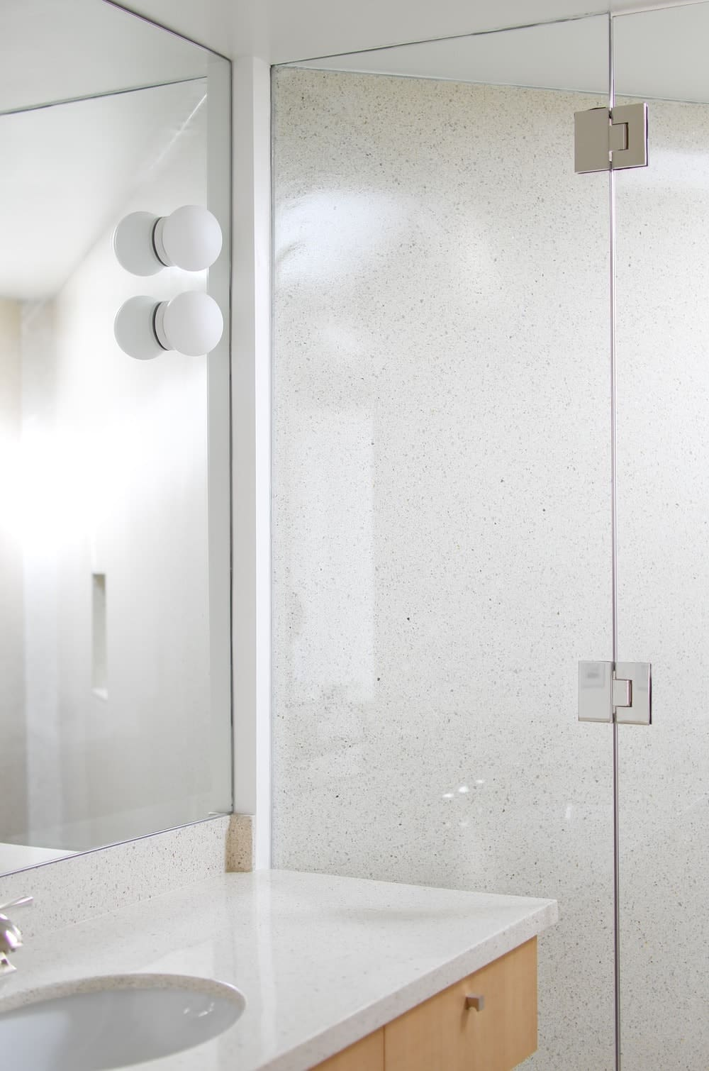 The bathroom offers walk-in shower and marble countertop sink. Photo Credit: Gerhard Heusch