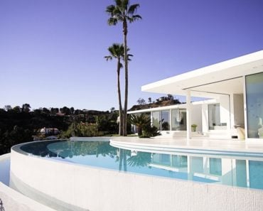 Another outside view of the house featuring its beautiful white architecture. Photo Credit: Gerhard Heusch