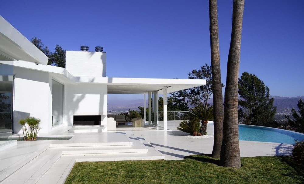 Outdoor view of the house featuring its beautiful backyard. Photo Credit: Gerhard Heusch