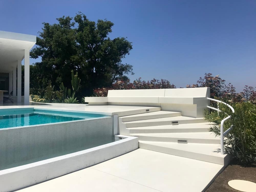 The swimming pool offers a wide bench-type sitting lounge. Photo Credit: Gerhard Heusch