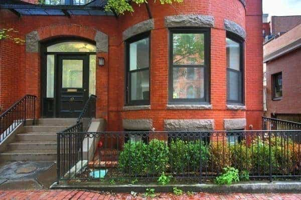 New contemporary open concept townhouse in Boston with red brick exterior.