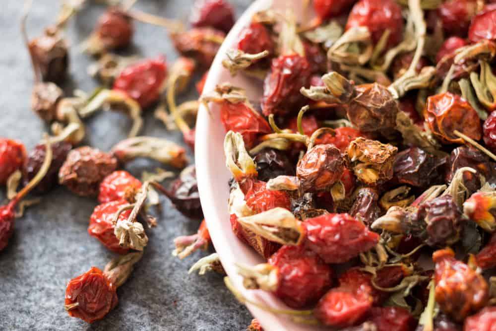 Dried ripe rose hip fruit served in a bowl.