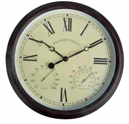 Round maritime clock with a deep brown, plastic frame.