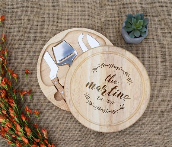 Round and wooden, personalized cutting board.