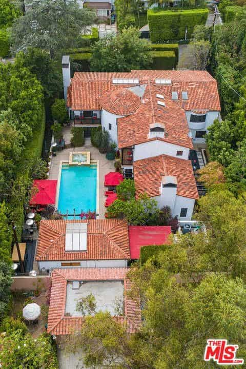 The aerial view of the house boasts the majestic landscaping surrounding the property.