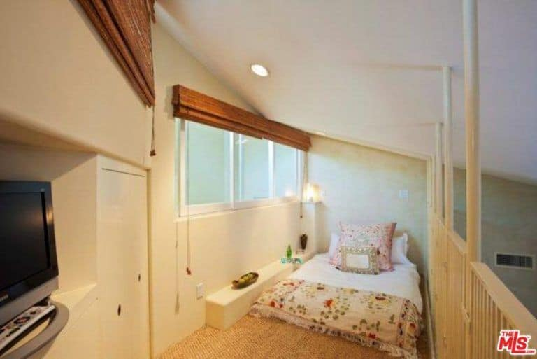 The home also features a small bedroom with a TV and recessed ceiling lights.