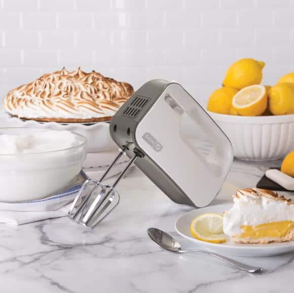 Silver hand mixer with smart storage and 3-level speed options.