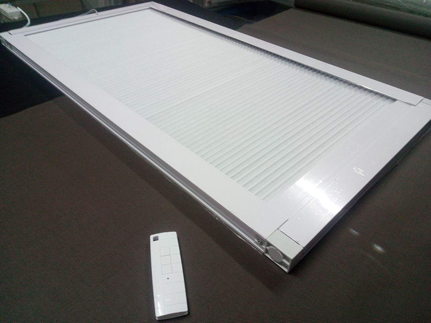 This skylight window shade effectively regulates the brightness of your room by adjusting the fabric open or closed with pole or motorize remote control if at motorize system.