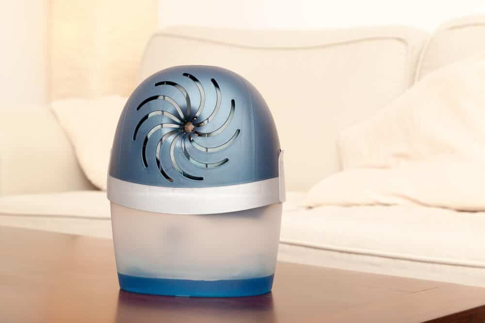 Small dehumidifier with a frosted blue finish.