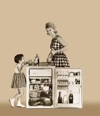 A mother and her child enjoying their drink from the small refrigerator.