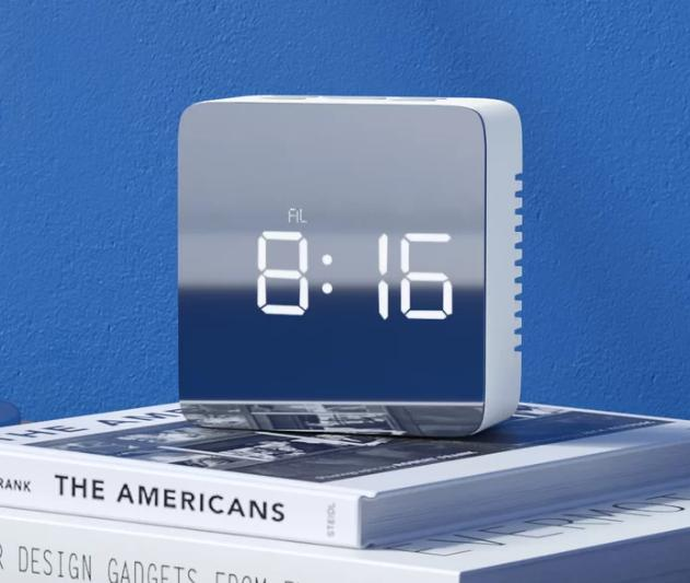 Square-shaped digital clock with a sleek finish.