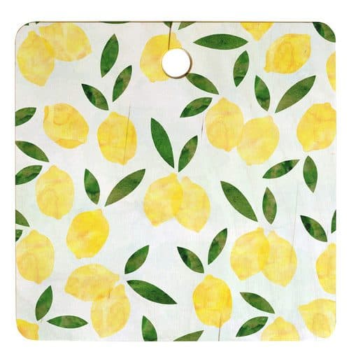 A square cutting board with lemon graphics.