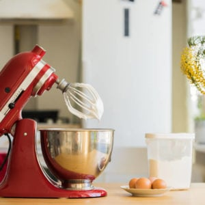 Red electric, stand mixer in the kitchen.